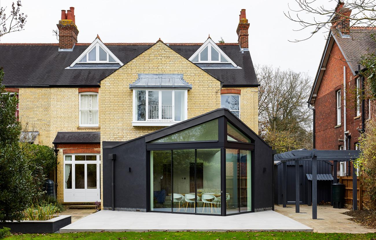 Modern extension with dark render cambridge