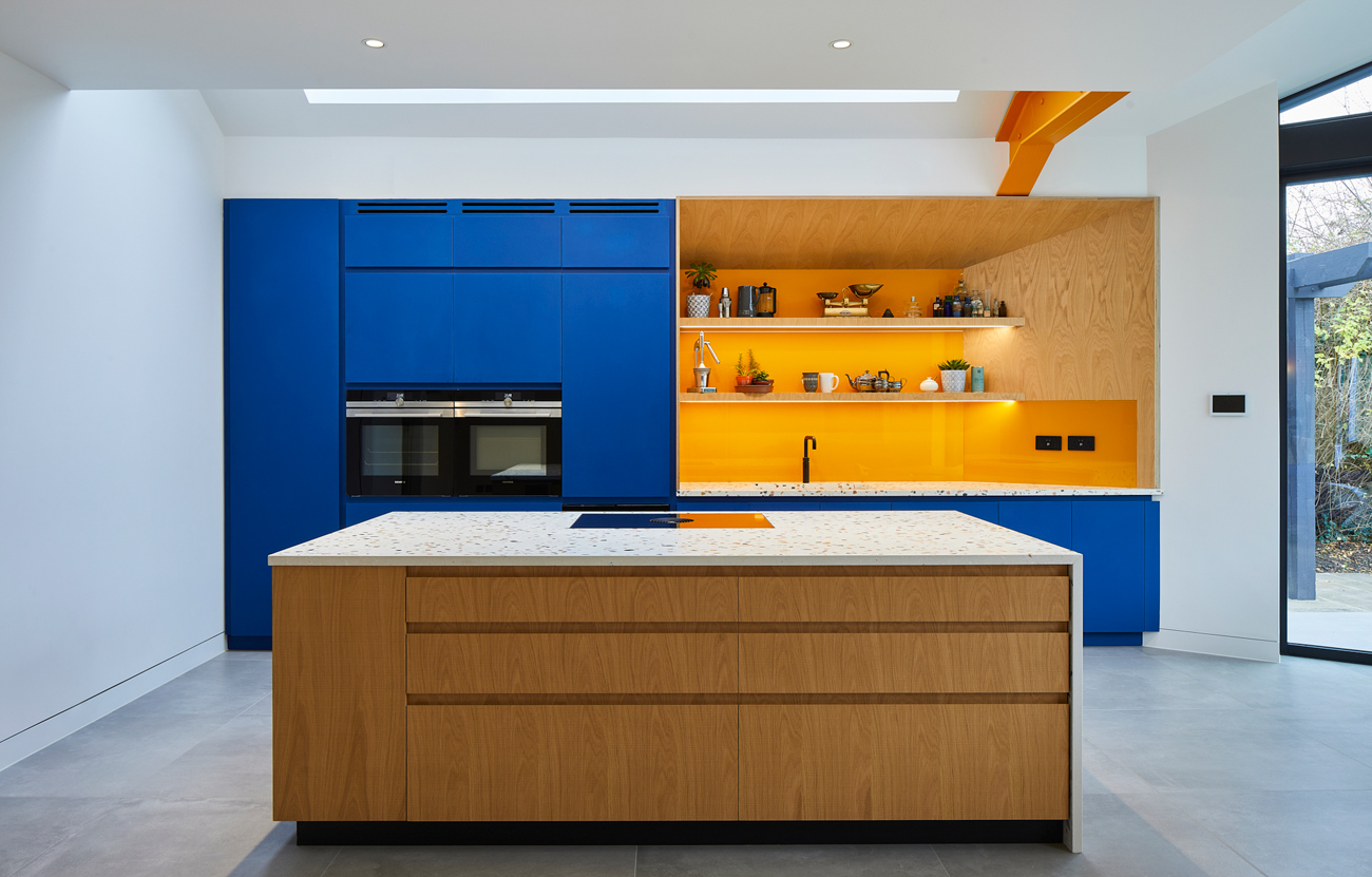 Contemporary kitchen with blue doors