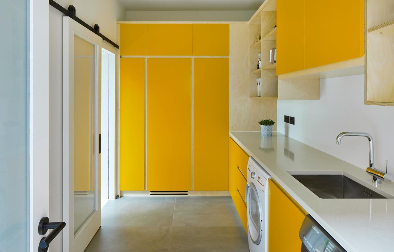 Modern utility with yellow doors cambridge
