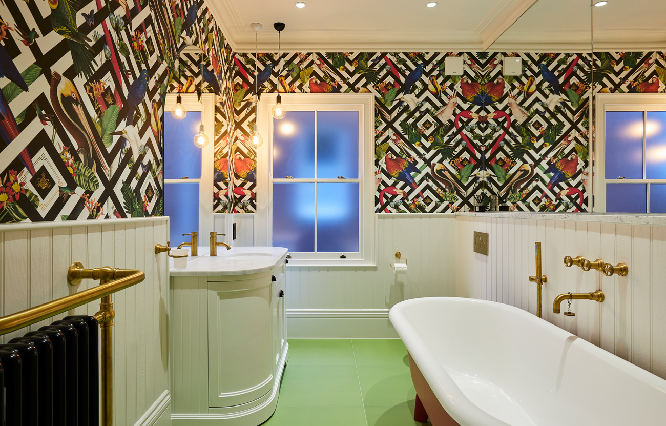 Modern bright bathroom with feature wallpaper