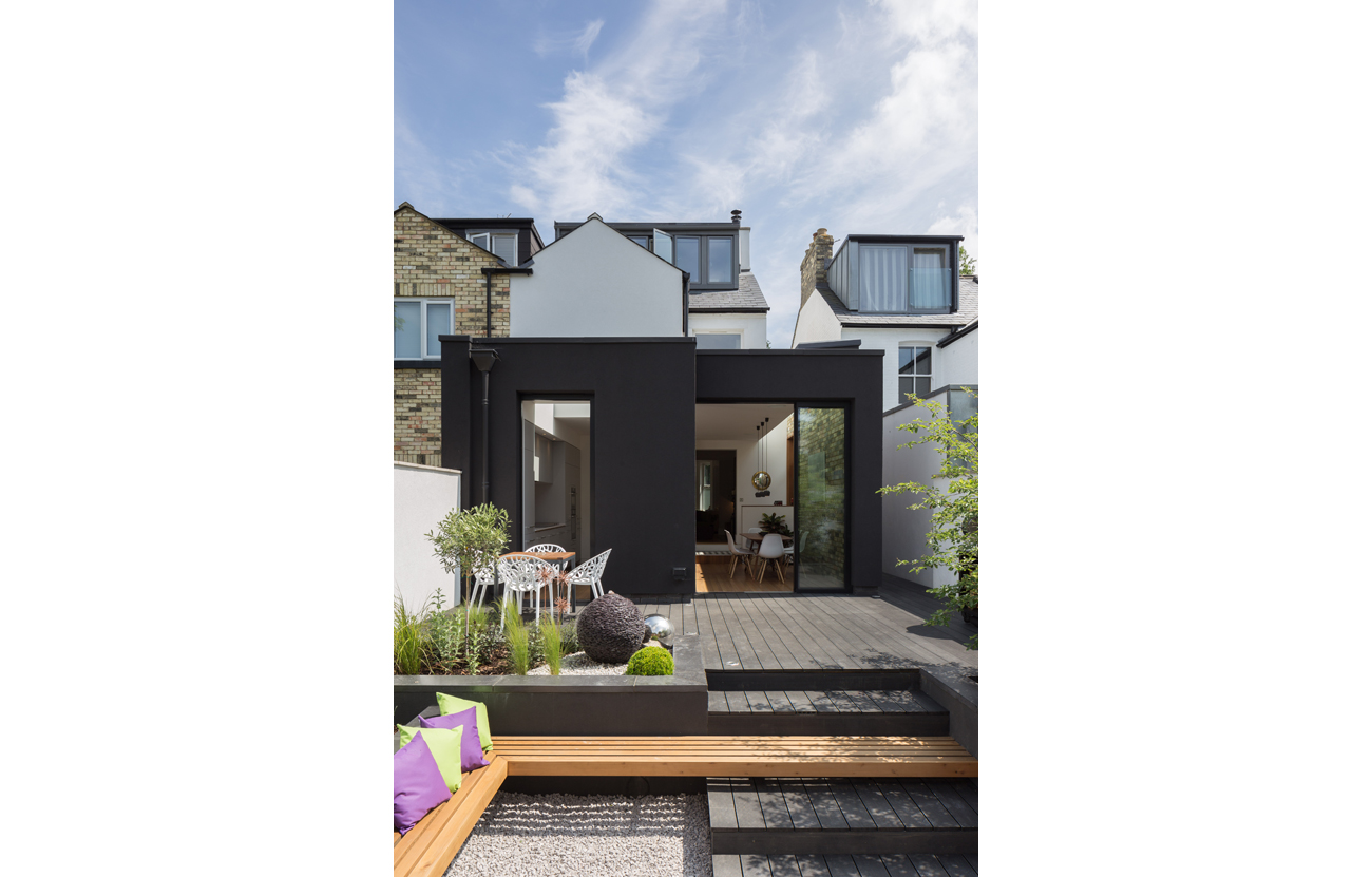 Modern black rendered extension