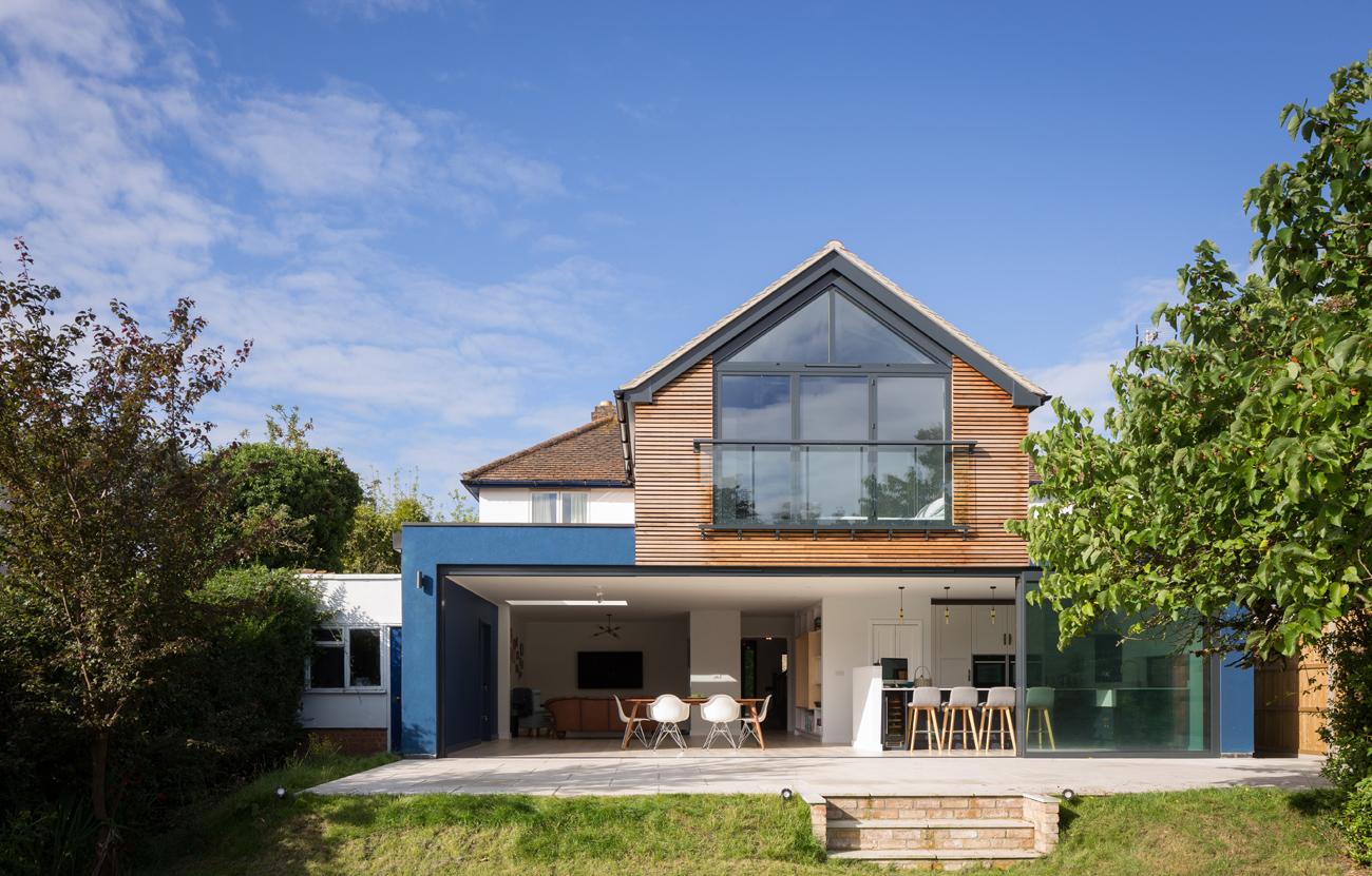 Blue render and cedar extension rear elevation