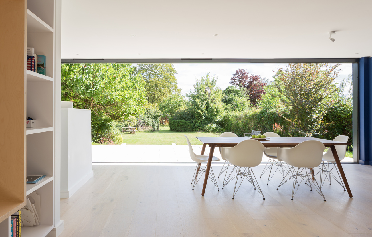 Interior view of modern extension with Eames dining chairs