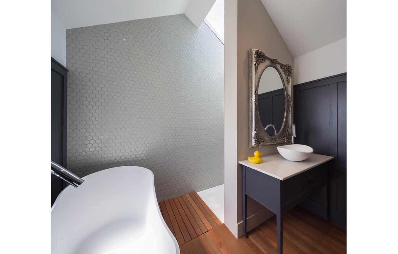 Frameless roof light above shower enclosure