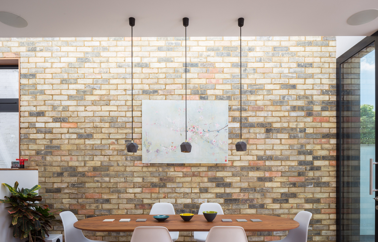 Exposed internal brickwork with dining table