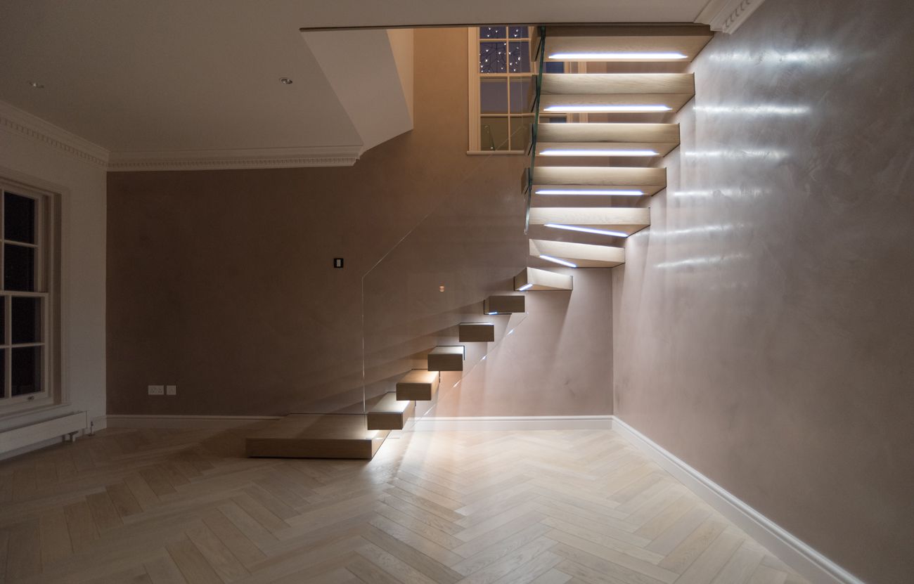 Floating timber stair illuminated